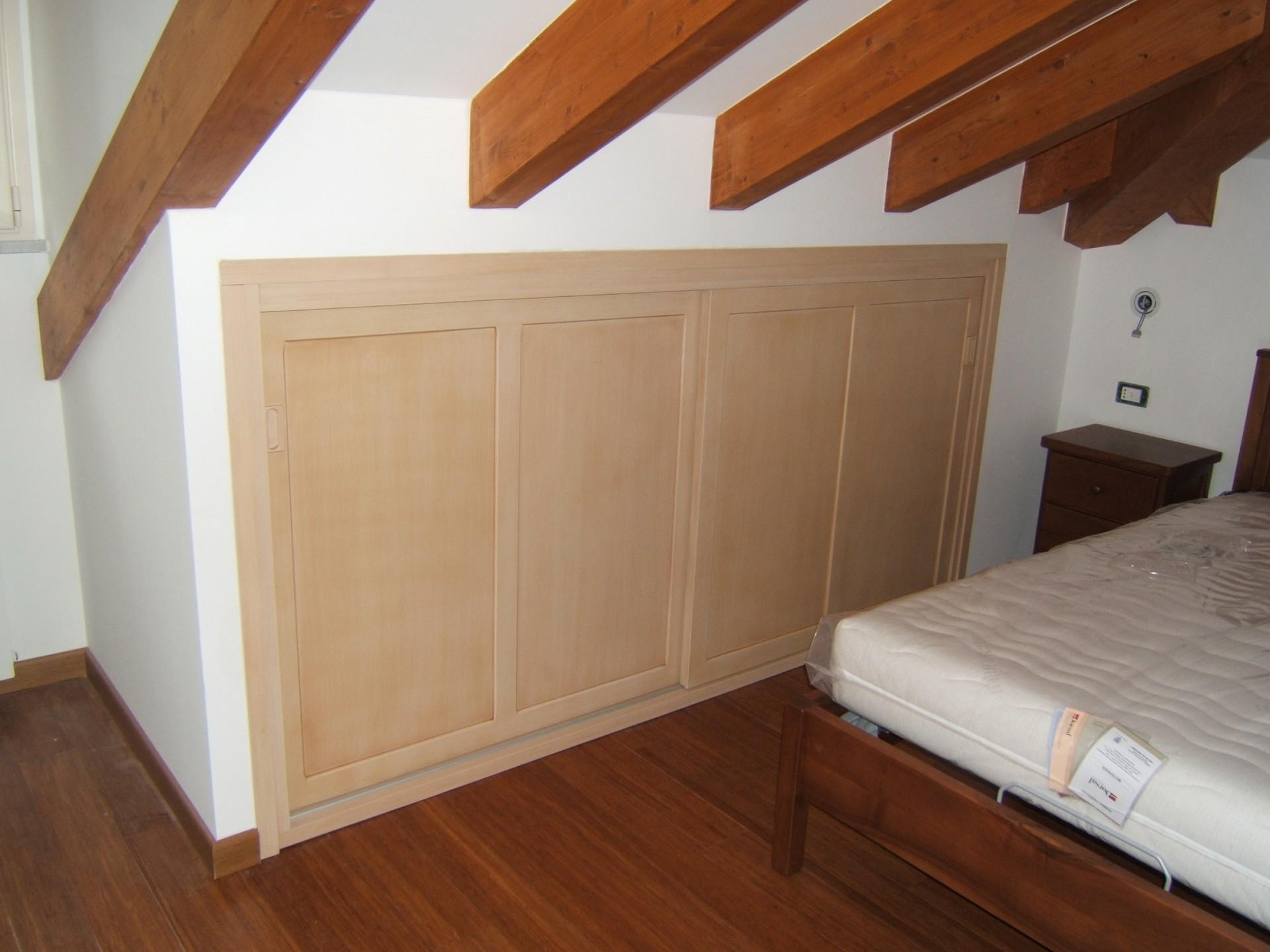 Mobili per mansarda legno design casa creativa e mobili for Offerte mobili verona