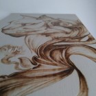 Disegni con pirografo su legno.